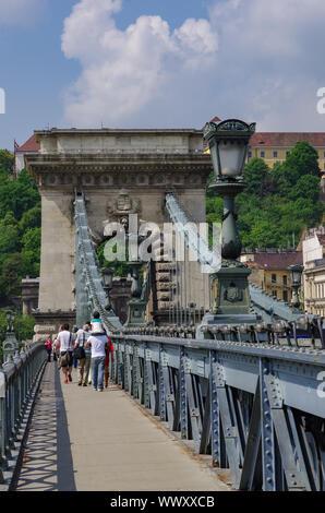 Budapest, Hungary - May 19, 2010: Pedestrians on the Szechenyi Chain Bridge. - Stock Photo