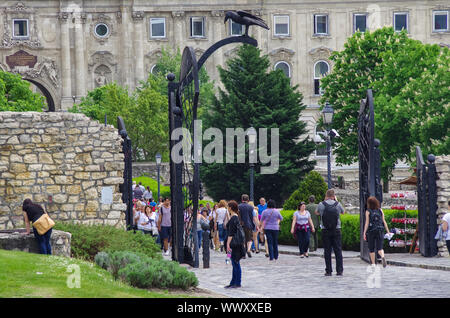 Budapest, Hungary - May 19, 2010:   Corvin Gate on St. George Square of Royal Palace of Budapest,with big black raven on top, symbolizing of King Matt - Stock Photo