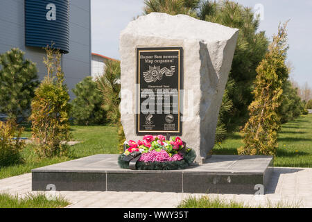 Vityazevo, Russia - April 22, 2016: Close-up of a memorial sign wars athletes who died in the Great Patriotic War, set in the al - Stock Photo