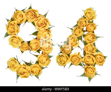 Arabic numeral 94, ninety four, from yellow flowers of rose, isolated on white background - Stock Photo