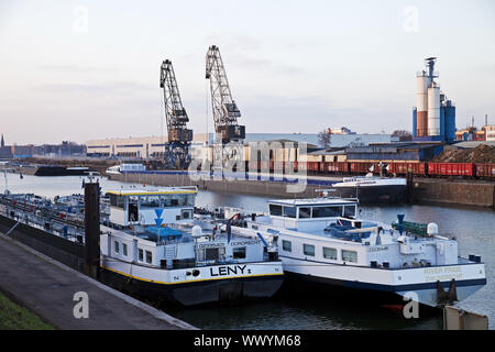 freight ships and cranes in inland port Duisburg, Ruhr Area, North Rhine-Westphalia, Germany, Europe - Stock Photo