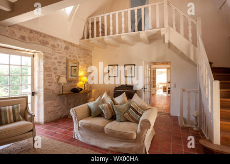 Beatiful French style large living room with mezanine - Stock Photo