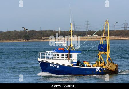 SU10 Inspiration a working trawler in Southampton Water, Hampshire, England, UK
