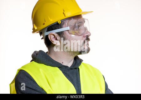 Do it yourself, man dressed in yellow builder helmet with protective glasses ready to start the construction work - Stock Photo