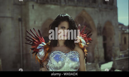 Silver armor, Beautiful brunette woman wearing gold and copper corset in goddess and warrior poses. fantasy and imagination conc Stock Photo