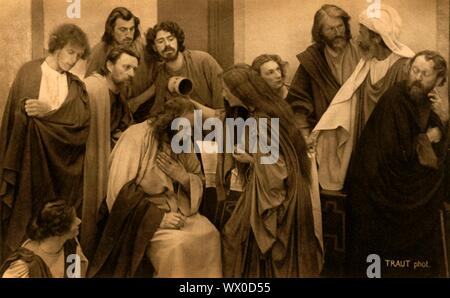The Anointing, 1922. Players in the Oberammergau Passion Play. The play is performed every 10 years, on open-air stages, by the inhabitants of the village of Oberammergau in Bavaria, Germany. First staged in 1634, the play tells the story of Jesus' passion, culminating in his crucifixion. The event has become a tourist attraction, with audiences coming from all over the world. Official postcard of the 1922 Oberammergau Passion Play. [F. Bruckmann, Munich, Germany, 1922] - Stock Photo