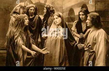 The wailing women, 1922. Paula Rendl as Mary Magdalene, Martha Veit as the Virgin Mary, Melchior Breitsamter as St John: players in the Oberammergau Passion Play. The play is performed every 10 years, on open-air stages, by the inhabitants of the village of Oberammergau in Bavaria, Germany. First staged in 1634, the play tells the story of Jesus' passion, culminating in his crucifixion. The event has become a tourist attraction, with audiences coming from all over the world. Official postcard of the 1922 Oberammergau Passion Play. [F. Bruckmann, Munich, Germany, 1922] - Stock Photo