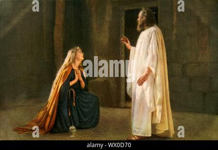 Jesus appears to Mary Magdalene, 1922. Mary Magdalene (Paula Rendl) kneels before Jesus (Anton Lang): players in the Oberammergau Passion Play. The play is performed every 10 years, on open-air stages, by the inhabitants of the village of Oberammergau in Bavaria, Germany. First staged in 1634, the play tells the story of Jesus' passion, culminating in his crucifixion. The event has become a tourist attraction, with audiences coming from all over the world. Official postcard of the 1922 Oberammergau Passion Play. [F. Bruckmann, Munich, Germany, 1922] - Stock Photo