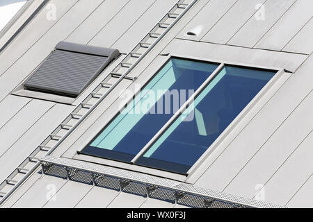 skylight windows on rooftop of modern building - Stock Photo