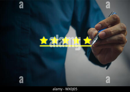 Conceptual the customer responded to the survey. The client using digital pen write five stars icon. Depicts that customer is very satisfied. Service - Stock Photo
