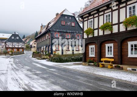 historical Upper Lusatian half-timbered houses in Waltersdorf Zittauer Gebirge - Stock Photo