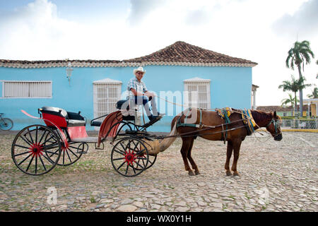 Cowboy waiting for riders with his horse and carriage in Plaza Mayor, Trinidad, UNESCO, Cuba, West Indies, Caribbean, Central America - Stock Photo