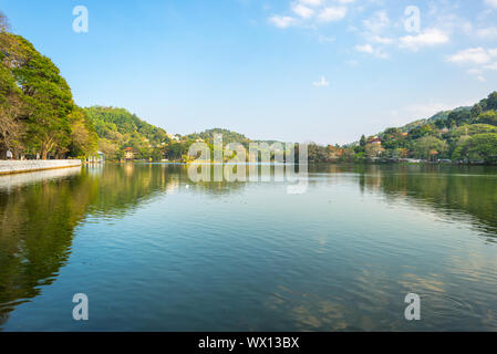 The lake in Kandy is a favourite place to be for locals and tourists - Stock Photo