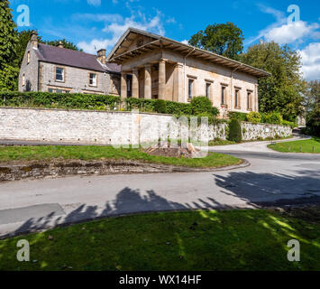 Extraordinary Doric portico of All Saints Roman Catholic church in the village of Hassop in the Derbyshire Peak District UK - Stock Photo