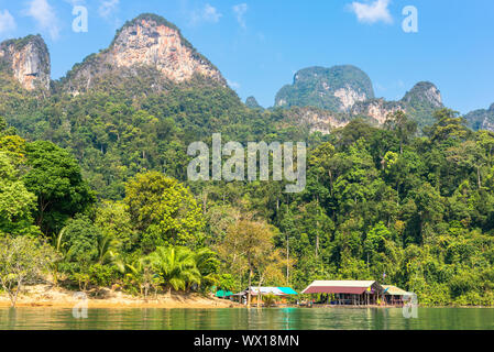 The Khao Sok National Park with the artificial Cheow Lan Lake in the south of Thailand - Stock Photo