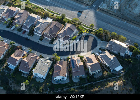 Aerial late afternoon view of suburban San Fernando Valley cul-de-sac street in Los Angeles, California. - Stock Photo