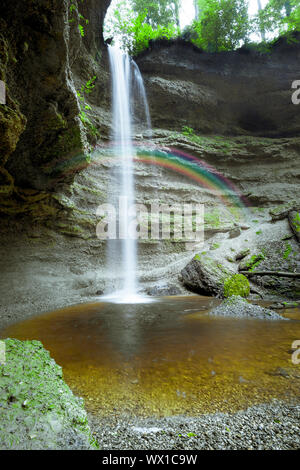 An image of a nice waterfall with rainbow at the Paehler Schlucht in Bavaria Germany - Stock Photo