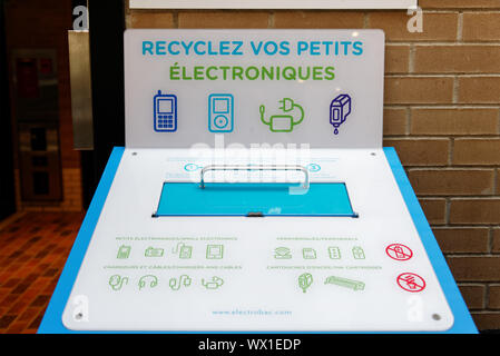 A recycling bin for cell phones in Montreal, Quebec - Stock Photo