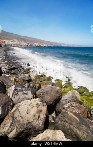 Black sandy beach in famous Candelaria town in Tenerife - Stock Photo