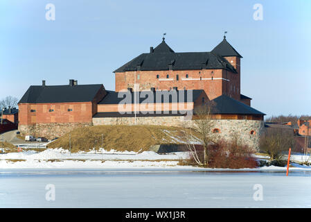 View of an old prison fortress on the shore of Lake Vanajavesi on a sunny March day. Finland, Hameenlinna - Stock Photo