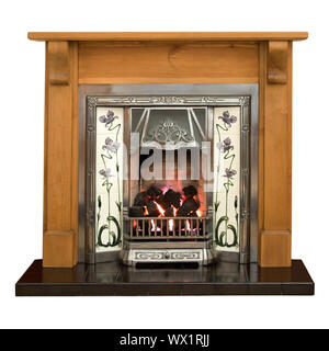 Victorian style tiled fireplace with pine surround - Stock Photo