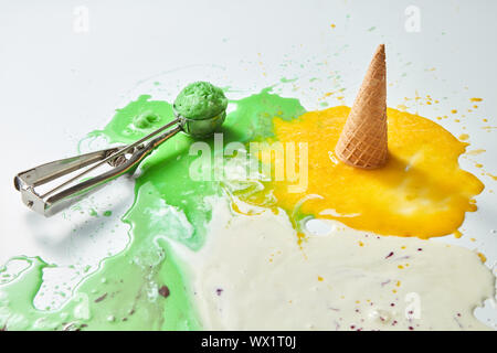 Colorful ice cream cones of different flavors. Melting scoops. Top view, copy space, steel metal background - Stock Photo