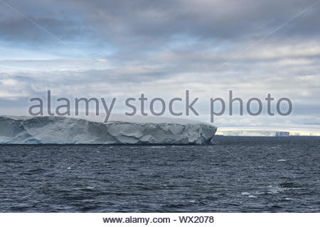 Huge Tabular Icebergs floating in Bransfield Strait near the northern tip of the Antarctic Peninsula, Antarctica - Stock Photo