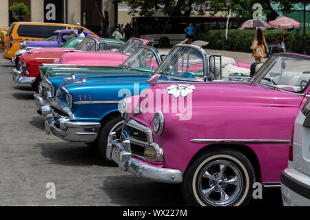 LA HAVANA, CUBA - JUNE  27, 2019: Traditional taxi in Havana Downtown waiting for customers in city sightseeing in authentic and stylish cars from the - Stock Photo