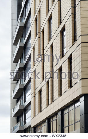 Modern architecture facade with balconies and windows - Stock Photo