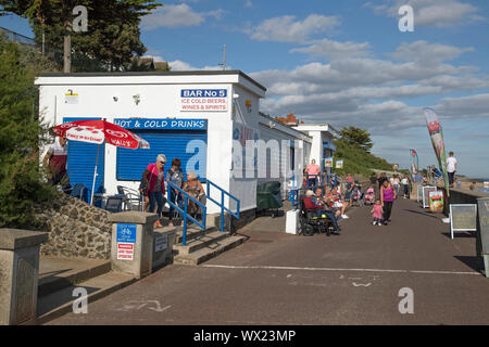 Clacton On Sea, Essex, England, September 15th 2019,  People wander on the seafront promenade on a sunny day. - Stock Photo