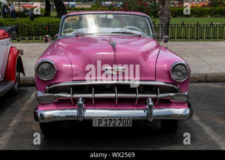 HAVANA, CUBA - JUNE  27, 2019: Traditional taxi in Havana Downtown waiting for costumers in city sightseeing in authentic and stylish cars from the '6 - Stock Photo