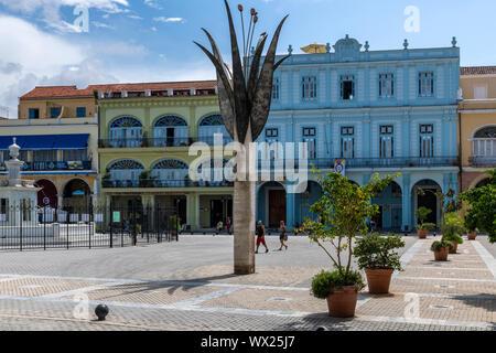 HAVANA, CUBA - JUNE  27, 2019:  Plaza Vieja with colorful buildings in La Habana a capital of Cuba. - Stock Photo