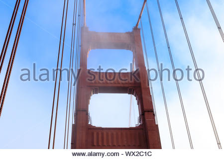 Fog rolling in on the Golden Gate Bridge tower. - Stock Photo
