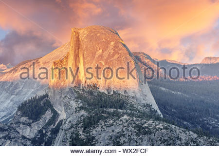 Sunset over Half Dome from Glacier Point. - Stock Photo
