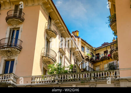 Beautiful ornate apartment building with balconies and gardens along Via IV Marzo ,Turin ,Italy - Stock Photo