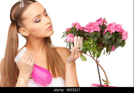 bright picture of lovely housewife with flowers - Stock Photo