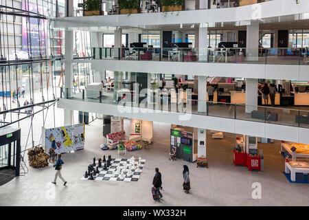 Atrium Dutch city hall Utrecht with people visting the building - Stock Photo