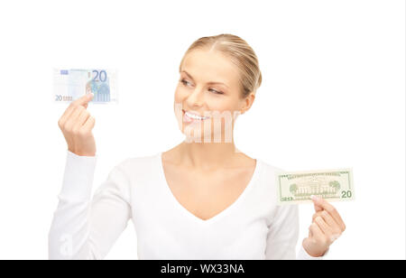 woman with euro and dollar money notes - Stock Photo