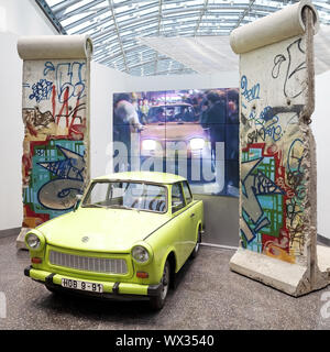 Original Berlin Wall with Trabi and film of the opening of the Berlin Wall in 1989, Bonn, Germany - Stock Photo