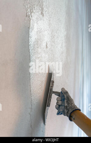 plastering wall and hand - Stock Photo
