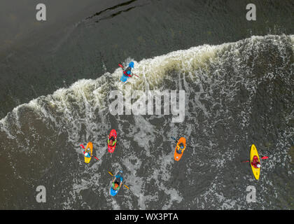 Aerial view of canoes on River Trent Burton Bridge Weir - Stock Photo