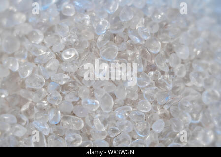background of small polished quartz and rock crystal stones in a giant pile - Stock Photo