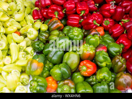Colorful mixed peppers green yellow red vegetables variety - Stock Photo