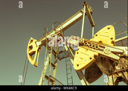 Oil pumpjack, industrial equipment. Rocking machines for power genertion. Extraction of oil. Petroleum concept. - Stock Photo