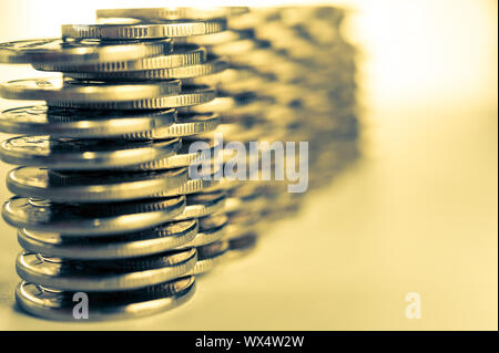 Stack of golden coins macro. Rows of coins for finance and banking concept. Economy trends background for business idea.
