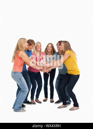 A group of friends smiling and getting ready to cheer - Stock Photo
