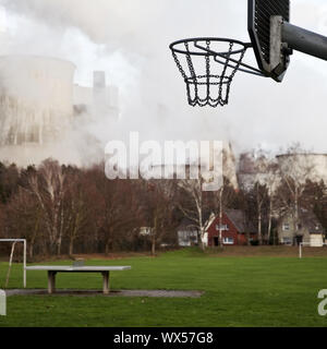 desolate sports ground in front of brown coal power station Niederaussem, Bergheim, Germany, Europe - Stock Photo