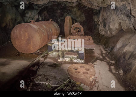 Metal parts in cave old machinery compressor World war one - Stock Photo