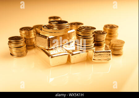 Gold bullions and stack of coins. Background for finance banking concept. Trade in precious metals. - Stock Photo