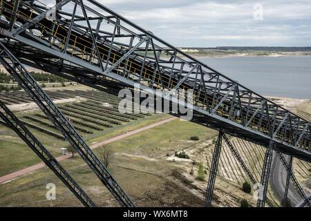 Overburden-conveyor bridge F60 in lignite mining - Stock Photo